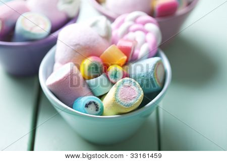 bowl full of colorful pastel marchmallows and rock candy