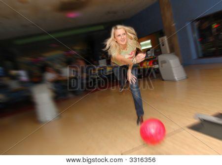 Girls Plays Bowling