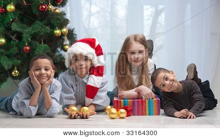 Children Holding Christmas Gifts