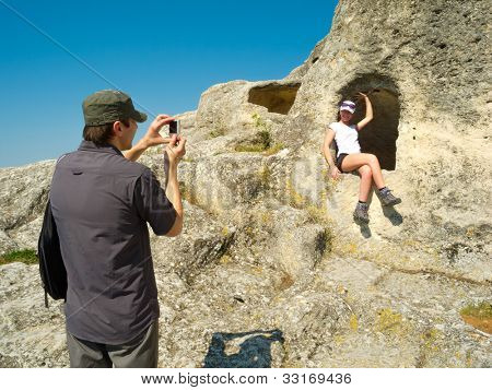 Couple of young hikers taking pictures outdoors