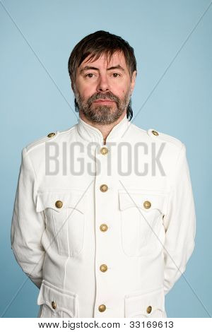 Middle aged man in the form of a naval officer.