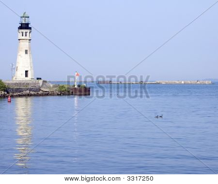 Lighthouse At Harbor Entrance