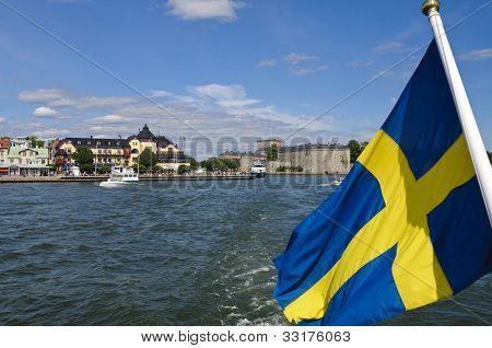 Vaxholm Fortress And Swedish Flag, Stockholm Archipelago, Sweden
