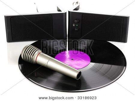 Black vinyl record with loudspeakers and microphone isolated on white