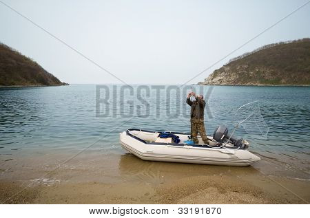 Fisherman in a boat after fishing in the sea.