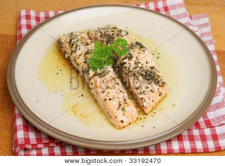 Salmon fillets baked in olive oil, lemon juice and herbs.
