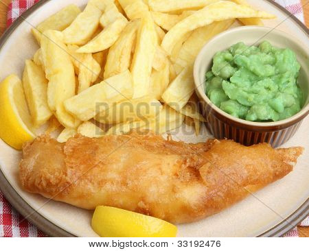 Cod fish, chips and mushy peas.
