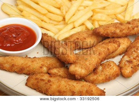 Breaded chicken goujons or niggets with fries and tomato ketchup