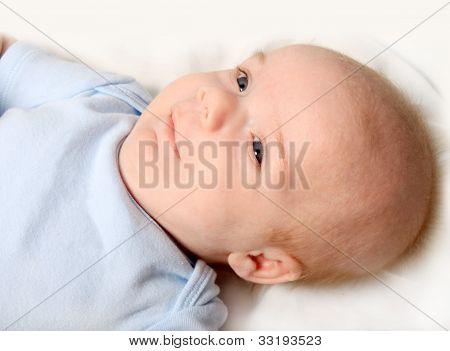 Little Newborn Baby Boy Smiling