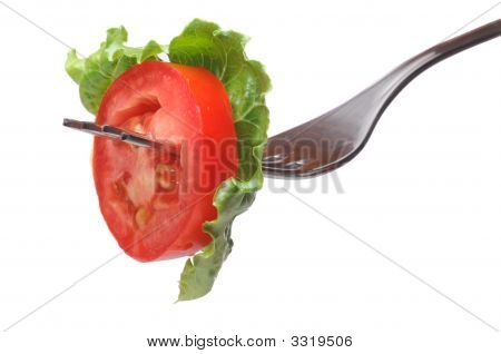 Fresh Tomato On Fork