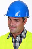 Close-up shot of a smiling tradesman