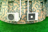 Air Conditioners On The Wall With Outdoor Stone Paneling, Air Compressors Installed Outside The Buil poster