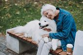 Happy Woman Hugging Her Lovely Fluffy Pedigree Dog poster