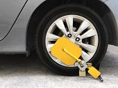 Anti-theft Tire Wheel Lock With Yellow Clamp. poster