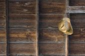 Straw Cowboy Hat And Weathered Wood poster