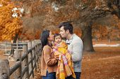 Asian Chinese Mother And Caucasian Father Dad Holding Kissing Baby Girl Wrapped In Blanket. Family I poster