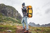 Brave Tourist With Travel Backpack Hiking In Mountains Outdoor Journey. Active Traveler Lifestyle Wa poster