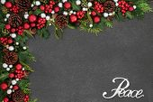 Christmas peace background border with silver sign, red and silver ball baubles, holly, mistletoe an poster