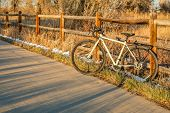 touring bike on a bike trail in late fall scenery - Poudre River Trail in northern Colorado poster