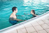 Father Teaches Girl To Swim In The Pool. Happy Father Teaching His Little Daughter To Swim. Active H poster