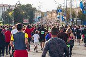 Many Athletes Run A Marathon On A City Road. poster