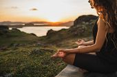 Healthy Lifestyle And Yoga Concept. Close-up Hands. Woman Do Yoga Outdoors At Sunrise In Lotus Posit poster