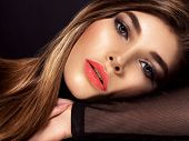 Beautiful face of  the  young woman.  Closeup face of woman with orange color lipstick on lips.  Mod poster
