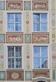 Windows With Decorations On The Wall Of Renovated Old Tenement House In Gdansk Old Town, Poland poster
