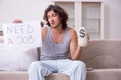 Unemployed man desperate at home poster
