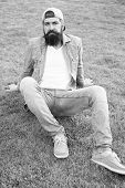 Brutal Handsome Hipster Man Resting On Summer Day. Bearded Man Trendy Hipster Style. Guy Modern Outf poster
