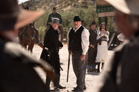 image of gunfights  - Cowboys draw weapons in an old American west gunfight - JPG