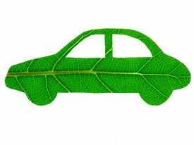 stock photo of non-biodegradable  - The stylised form of an automobile that has been cut from a green leaf  - JPG