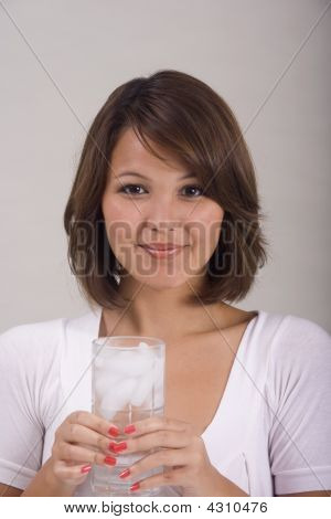 A Girl With A Glass Of Water
