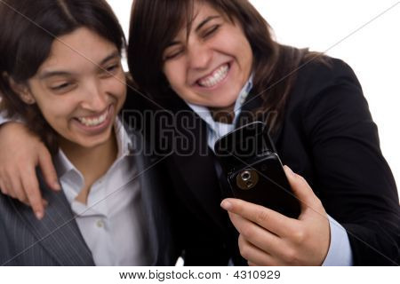 Businesswoman With Partner Laughing With Mobile Phone