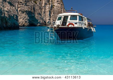Boat Anchored On Navagio Beach (also Known As Shipwreck Beach), Zakynthos Island, Greece