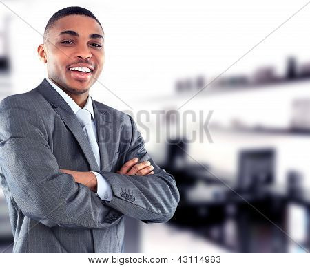 Portrait of a handsome successful business man busy working in his office