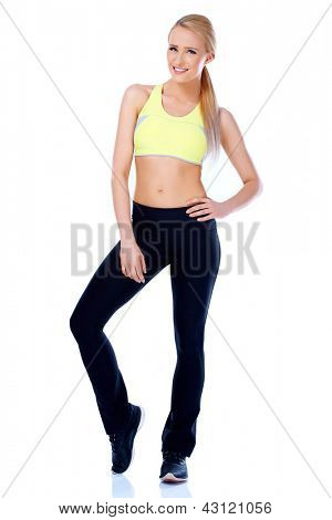 Full body shot of blond sporty woman on white background  she is smiling