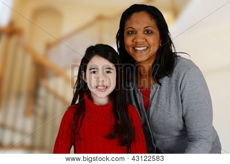 Woman and daughter standing inside their home