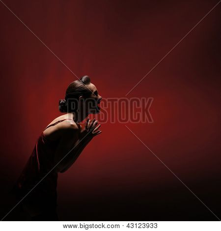Horror woman over red background