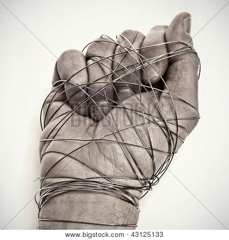 man hand tied with wire, as a symbol of oppression or repression, on a white background
