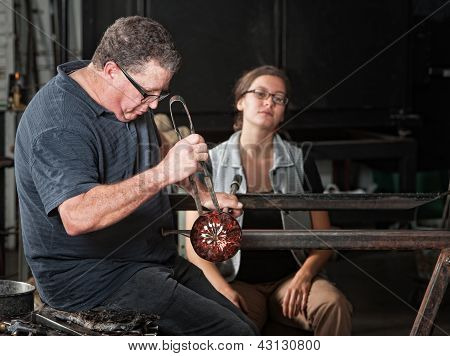 Student Watching Glass Worker