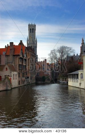 Bruges, Brugge, View On The Cathedral From The Canal.