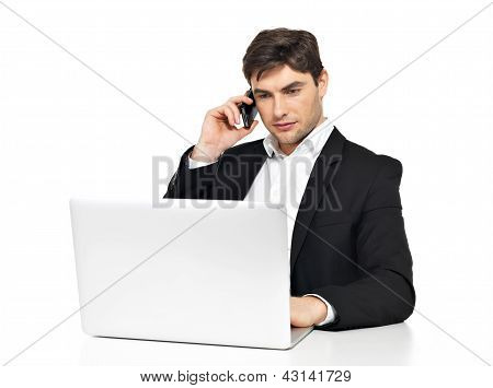 Office Worker With  Laptop Speaks By Mobile Phone