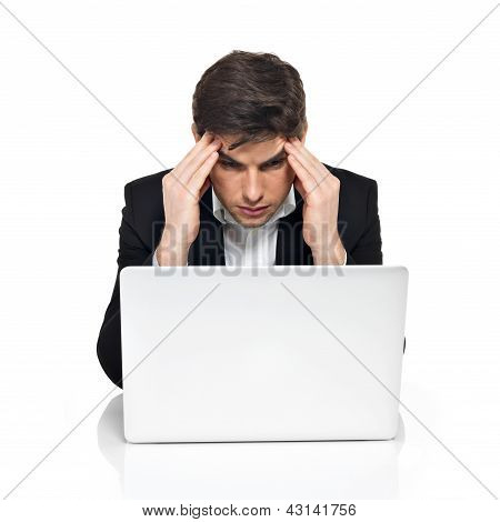 Young Office Worker With Laptop Having Stress