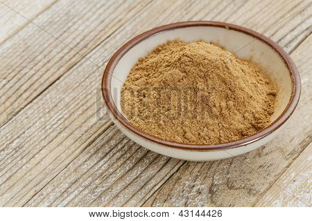 raw organic dried camu camu fruit powder (Myciara Dubia) in a small ceramic bowl - rainforest superfruit from Peru rich in vitamin C