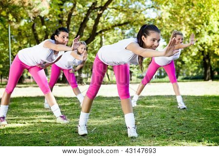 Young women on fitness class in park