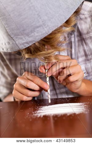 teenager boy snorting heroin