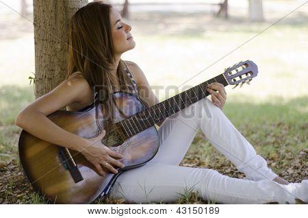 Cute girl playing a guitar