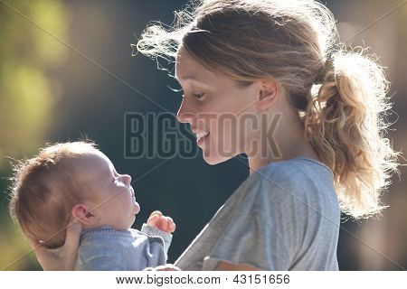 Mother And Baby In Park Portrait