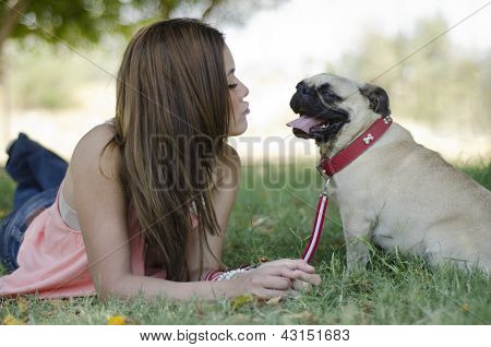 Blowing a kiss to her dog at a park